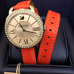 Swarovki watch with coral  leather strap.